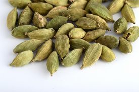 pic of cardamom  - Close up of Cardamom pods on white background - JPG