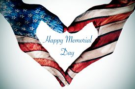 stock photo of memorial  - the text happy memorial day written in the blank space of a heart sign made with the hands of a woman patterned as the flag of the United States - JPG