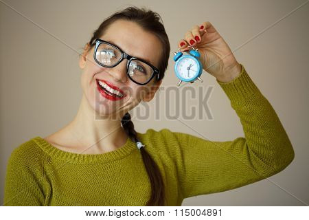 Little Blue Alarm Clock In The Hands Of An Emotional Young Woman