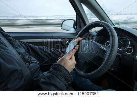 Driving Car And Holding Smartphone