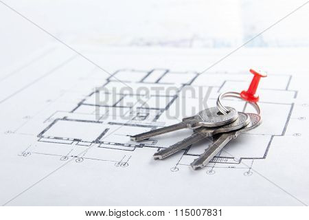 Model house, construction plan for house building, keys. Real Estate Concept.
