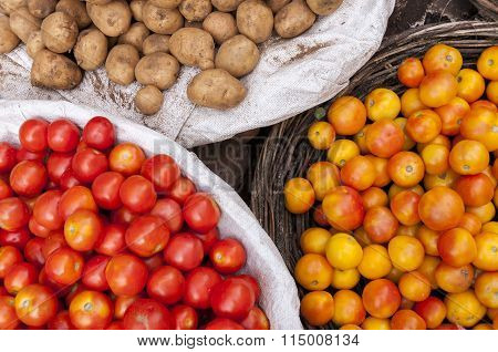 Tomatos And Potatos At The Market