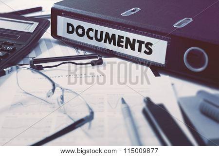 Documents on Office Folder. Toned Image.