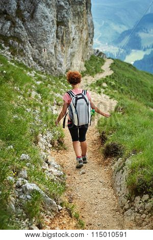 Woman Hiker With Backpack On Trail