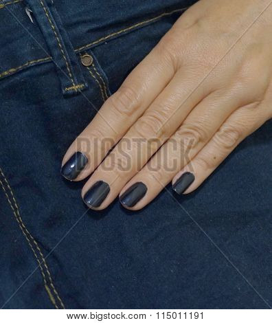 Jeans and a female hand