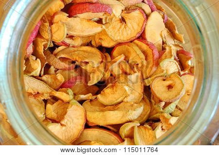 Dried Apples In A Glass Jar. Top View Down