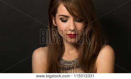 Beautiful lady posing with necklace in studio