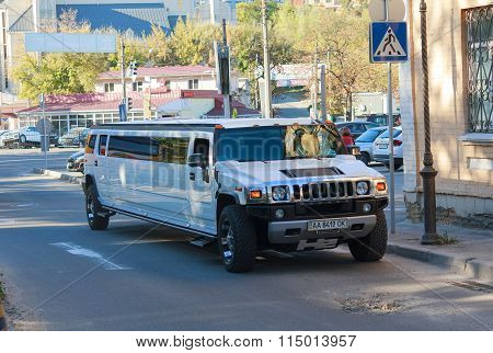 Kiev, Ukraine - October 03, 2015: Large And Luxurious White Limousine Hummer On City Street