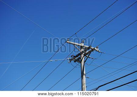 power pole under blue sky