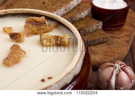 Fat Of The Lard In A Ceramic Dish