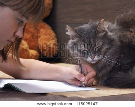 The child does his homework on the table