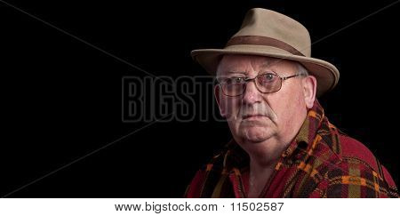 Senior Male Retired Wearing Glasses And Hat