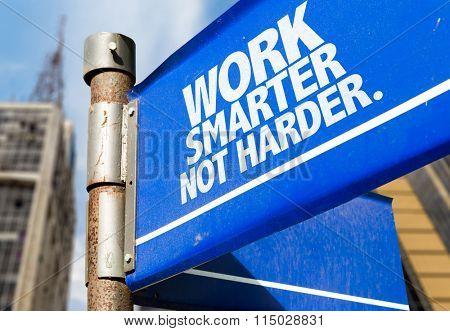 Work Smarter Not Harder written on road sign