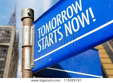 Tomorrow Starts Now! written on road sign