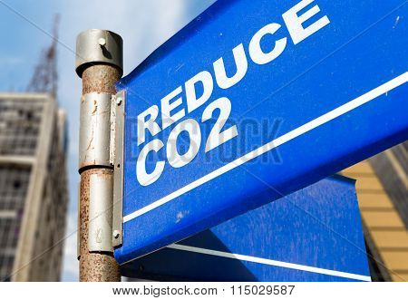 Reduce CO2 written on road sign