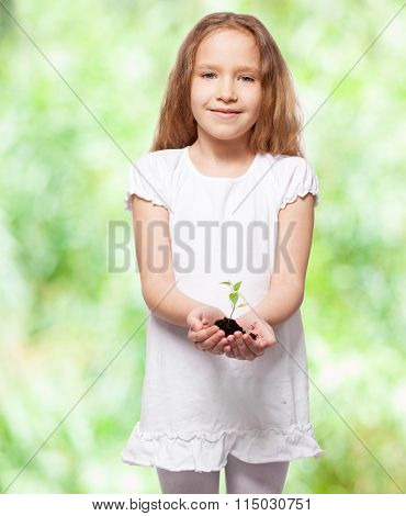 Child holding a seedling. Girl with sprout