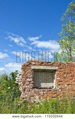 Desolate Brick House Ruins In The Meadow On Sunny Day