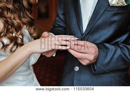 Groom Dresses Bride Wedding Ring