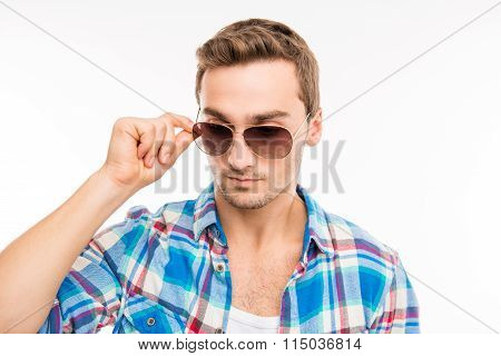 Minded Man Holding His Spectacles
