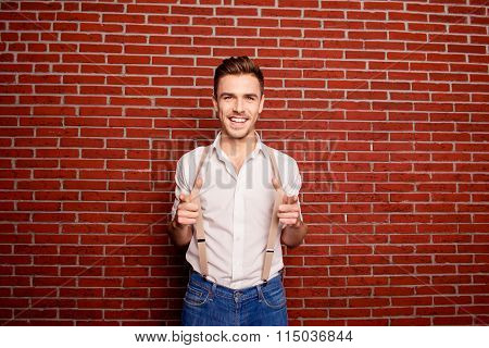 Smiling Man Holding His Suspenders