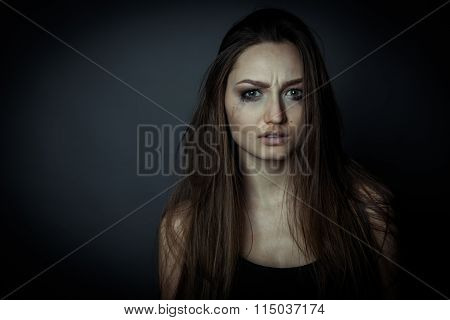 Close Up Portrait Of A Sad Woman, Hair Disheveled.