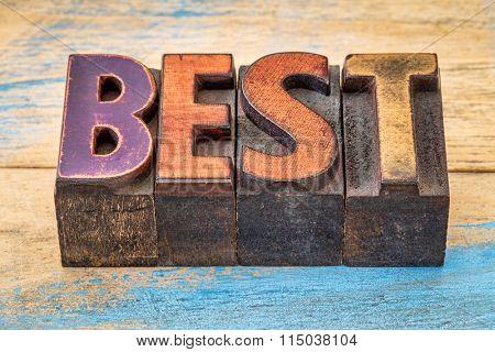 best word in vintage letterpress wood type printing blocks against painted wood