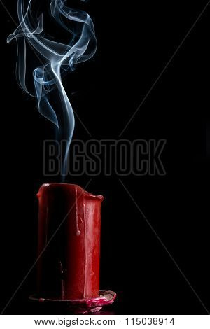 Gray Smoke From The Red Candle That Went Out