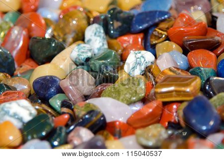 Scattering of colorful smooth stones.