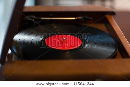 close up of vintage record player with vinyl disc