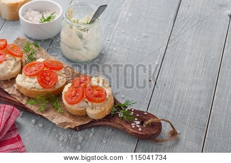 Canapes With Curd Cheese, Cherry Tomatoes And Dil