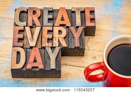 create every day words in vintage letterpress wood type printing blocks against painted wood with a cup of coffee