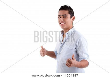 Young Latin Man With Thumbs Raised As A Sign Of Ok, Isolated On White Background. Studio Shot