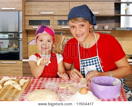 mother and daughter making rolls