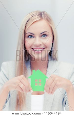 woman with illustration of eco house