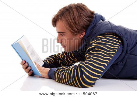 Man Lying Reading A Book, Isolated On White, Studio Shot.