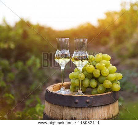 Two Glasses Of Liquor Or Grappa With Bunch Of Grapes