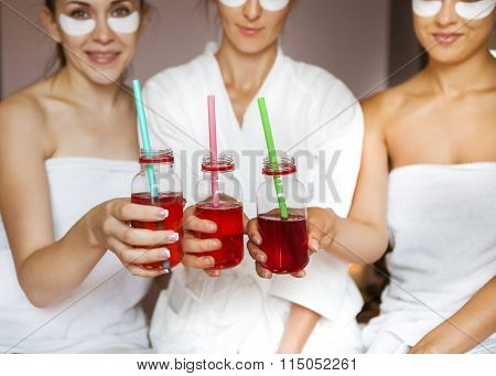 Young Happy Female Friends Drinking Juice In Spa And Have Fun
