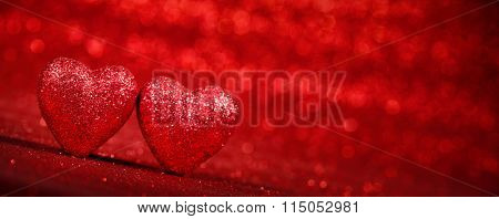 Red glitter background with hearts,valentines day concept.