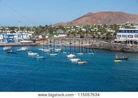 LANZAROTE SPAIN - SEPTEMBER 9 2015: Fishing boats in Playa Blanca Canary Island Lanzarote.Spain