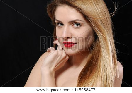Close Up Fashion Portrait Of Beautiful Young Blonde Woman On Black Background