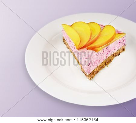 Piece Of A Colorful Homemade Cheesecake With Fruits