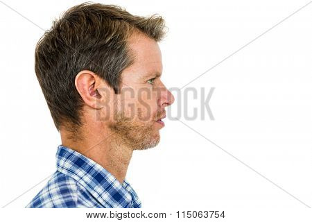 Serious man looking away while standing over white background