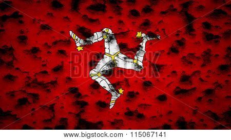 Flag of the Isle of Man painted on wall with bullet holes