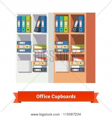 Office cupboards full of ring binders and papers