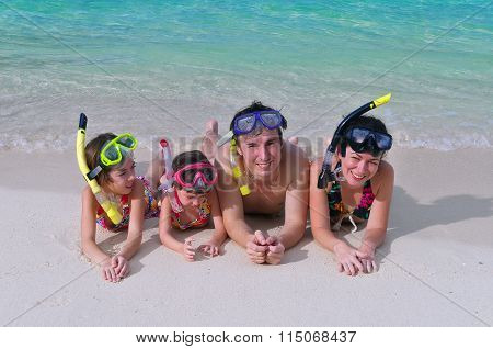 Happy family snorkeling and having fun on tropical beach vacation
