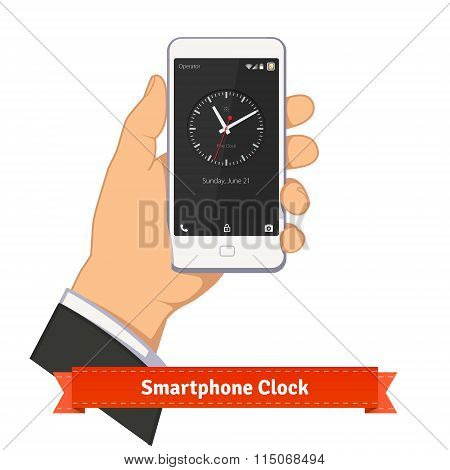 Hand holding smartphone with round clock widget