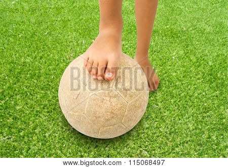 Barefoot Kid Playing Football