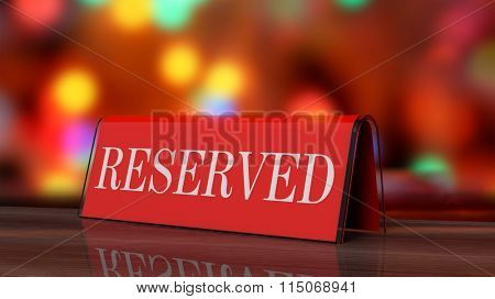 Red glossy reservation sign on wooden surface, with festive background.