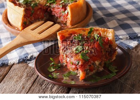 Piece Of Chicago Deep Dish Pizza Closeup On A Plate. Horizontal