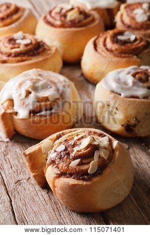 Cinnamon Rolls With Almond Close Up On The Table. Vertical